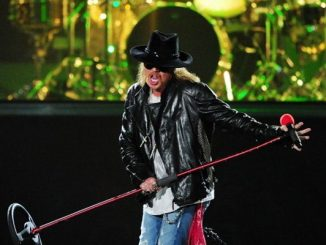 TOWNSVILLE, AUSTRALIA - DECEMBER 01:  Axl Rose of Guns N' Roses performs on stage at Reid Park on December 1, 2010 in Townsville, Australia.  (Photo by Ian Hitchcock/Getty Images)